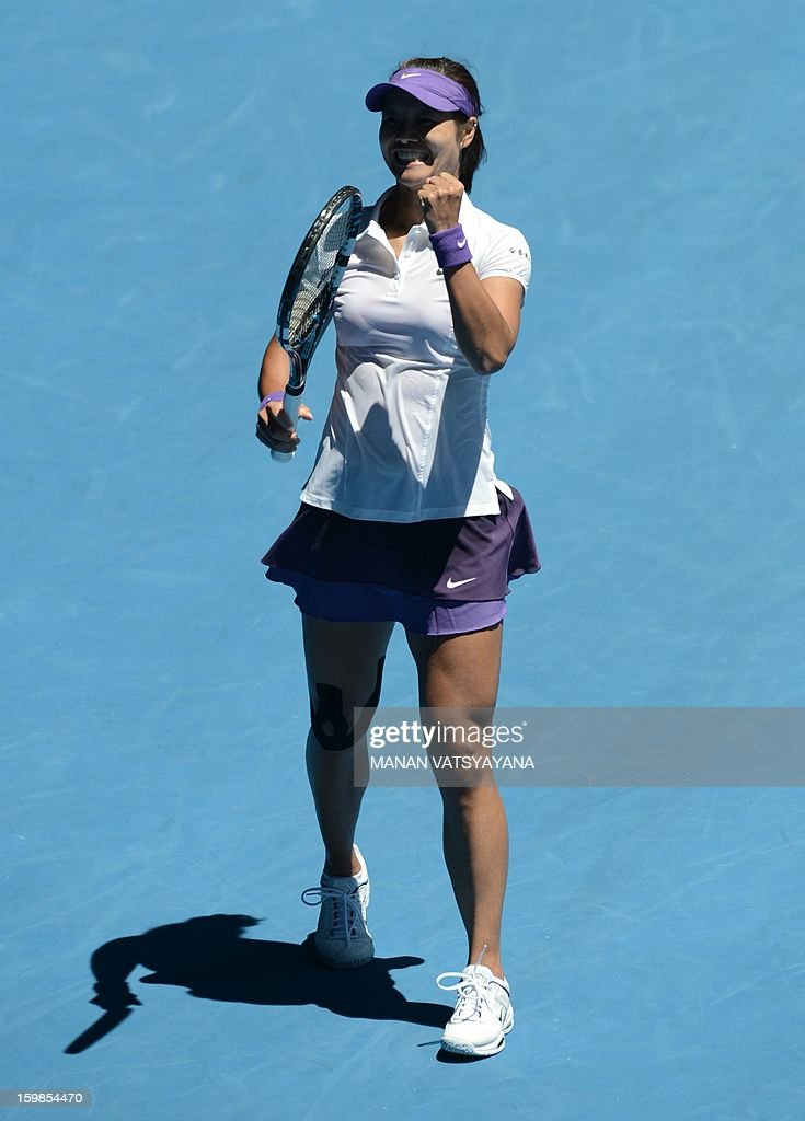 China's Li Na celebrates after beating Poland's Agnieszka Radwanska during their women's singles match on day nine of the Australian Open tennis tournament in Melbourne on January 22, 2013.