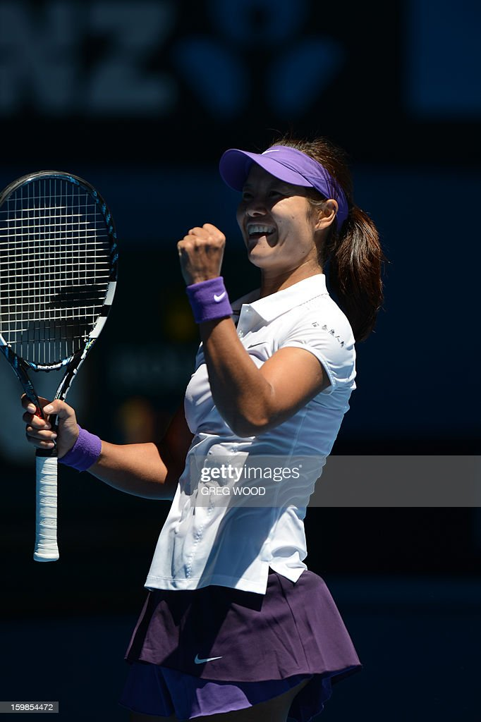 China's Li Na celebrates after victory in her women's singles match against Poland's Agnieszka Radwanska on the nineth day of the Australian Open tennis tournament in Melbourne on January 22, 2013.