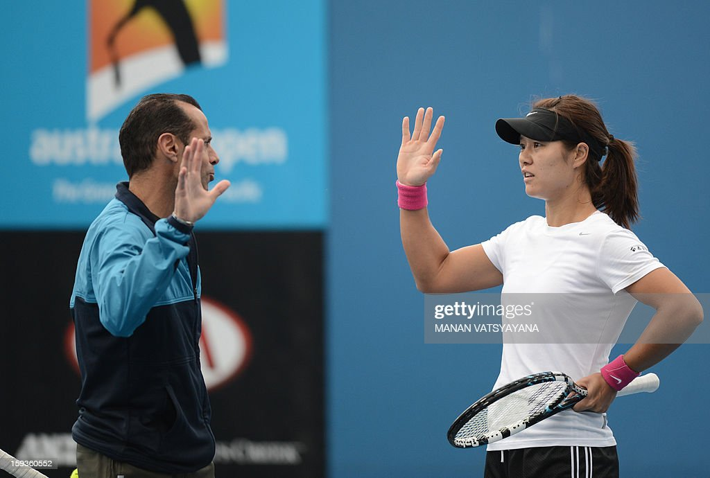 China's Li Na gestures to her coach Carlos Rodriguez during a practice session ahead of the 2013 Australian Open tennis tournament on January 13 2013...