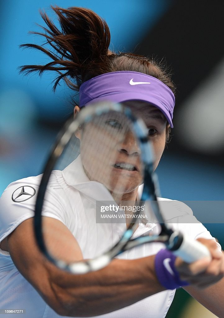 China's Li Na hits a return against Romania's Sorana Cirstea during their women's singles match on day five of the Australian Open tennis tournament in Melbourne on January 18, 2013.