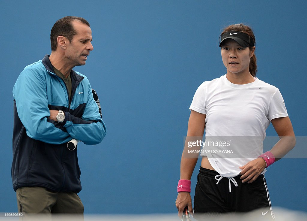 China's Li Na (R) looks on as her coach Carlos Rodriguez speaks during a practice session ahead of the 2013 Australian Open tennis tournament on January 13, 2013.