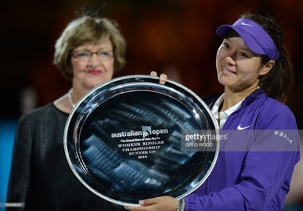 China's Li Na (R) poses with former champion Margaret Court as she holds the runners up trophy after defeat in her women's singles final against Belarus's Victoria Azarenka on day thirteen of the Australian Open tennis tournament in Melbourne on January 26, 2013.