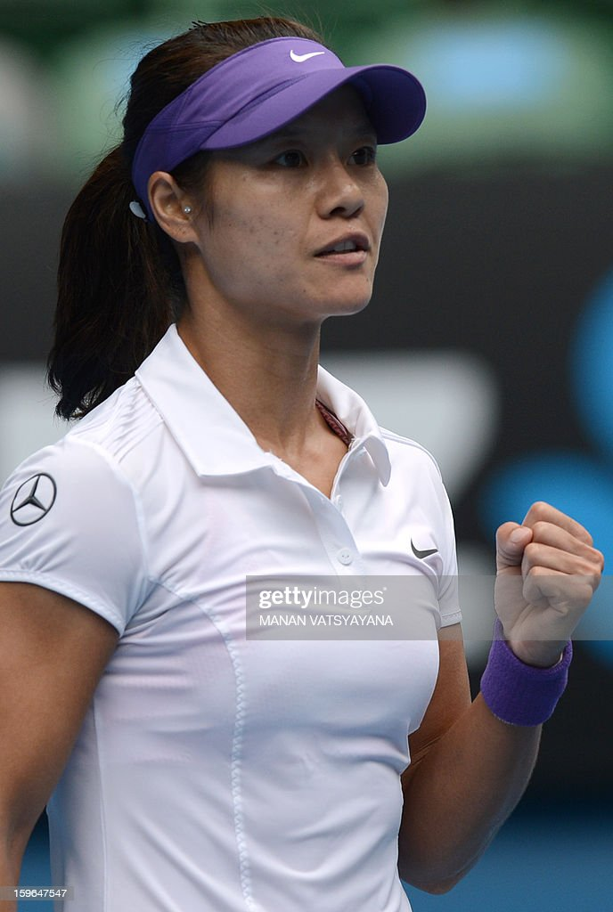 China's Li Na reacts after a point against Romania's Sorana Cirstea during their women's singles match on day five of the Australian Open tennis tournament in Melbourne on January 18, 2013.