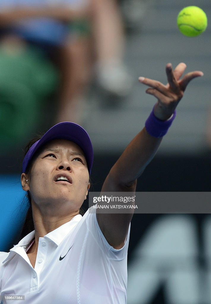 China's Li Na serves against Romania's Sorana Cirstea during their women's singles match on day five of the Australian Open tennis tournament in Melbourne on January 18, 2013.