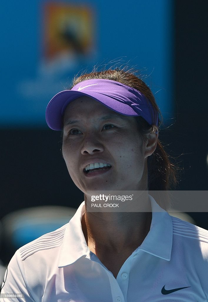 China's Li Na smiles after her victory against Poland's Agnieszka Radwanska during their women's singles match on day nine of the Australian Open tennis tournament in Melbourne on January 22, 2013. AFP PHOTO / PAUL CROCK IMAGE STRICTLY RESTRICTED TO EDITORIAL USE - STRICTLY NO COMMERCIAL USE