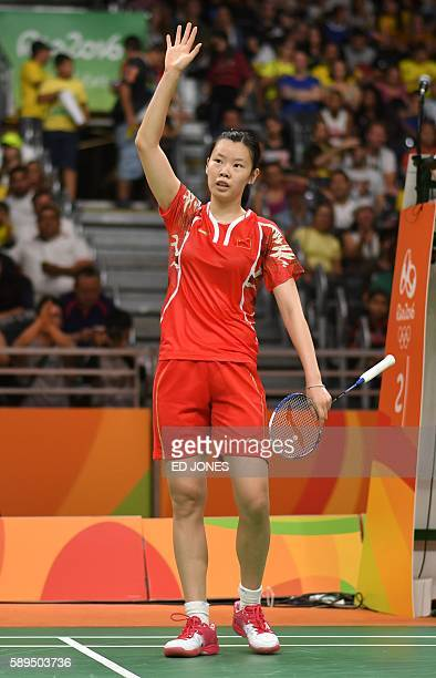 China's Li Xuerui acknowledges the crowd after winnging against US Iris Wang during their women's singles qualifying badminton match at the Riocentro...