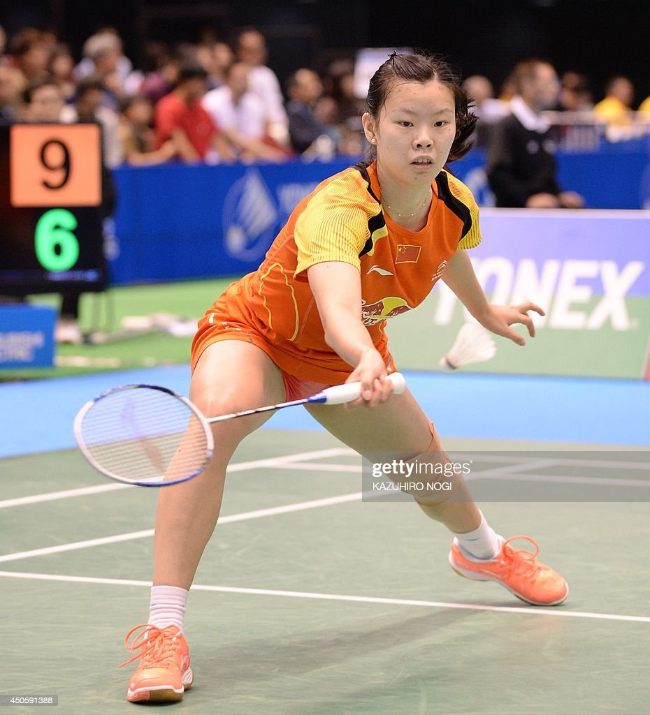 China s Li Xuerui hits a return against South Korea s Sung Ji Hyun
