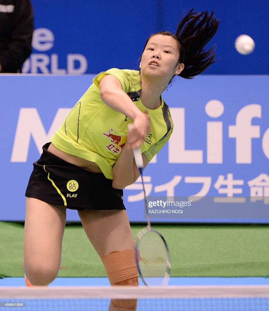 China s Li Xuerui smashes against Taiwan s Tai Tzu Ying during
