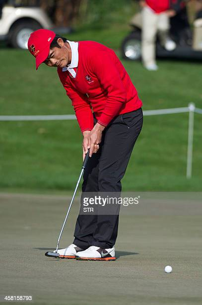 China's Liang Wenchong putts on the openingday of the seventh edition of the Royal Trophy at the Dragon Lake Golf Club's Asian Games Course in...