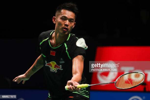 China's Lin Dan hits a return during the men's singles Sudirman Cup match against Kenta Nishimoto of Japan at the Gold Coast Sports Centre on May 27...