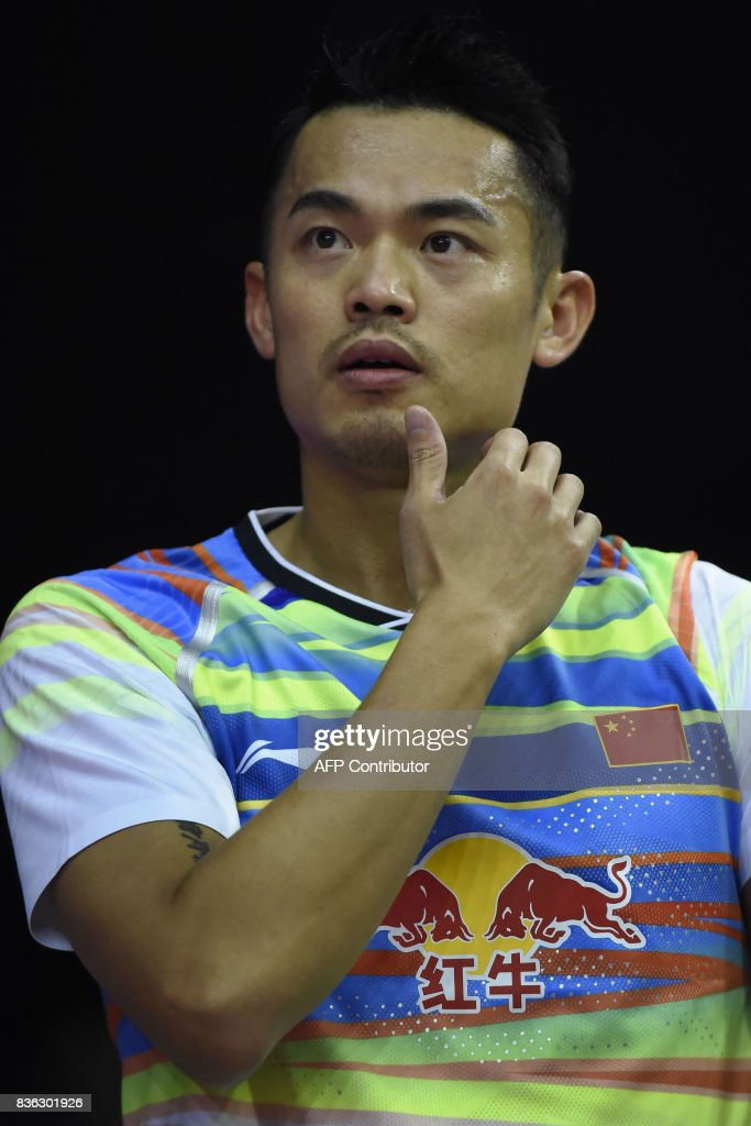 China's Lin Dan looks on during his preliminary round men's singles match against Scotland's Lieran Merrilees at the 2017 BWF World Championships of badminton at Emirates Arena in Glasgow on August 21, 2017. /