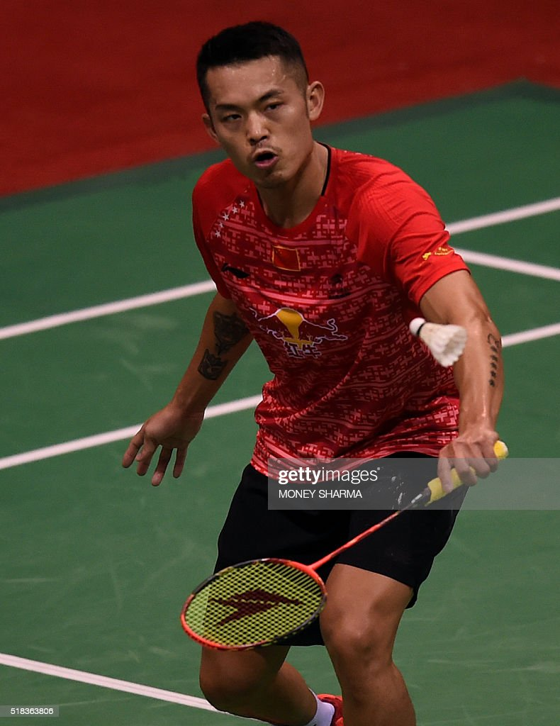 China s Lin Dan plays a shot against Korea s Son Wan Ho during the