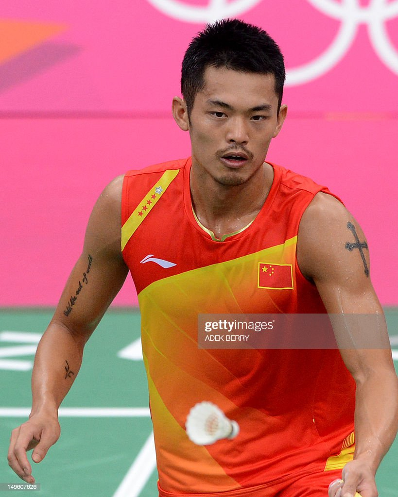 China s Lin Dan plays a shot to Taufik H