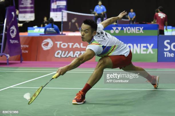China's Dan Lin returns returns during his preliminary round men's singles match against Scotland's Lieran Merrilees at the 2017 BWF World...