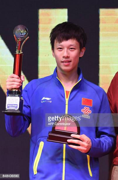 China's Lin Gaoyuan receives the Men's Winner's Trophy at the end of the ITTFATTU Asian Cup Table Tennis Tournament in the Indian city og Ahmedabad...