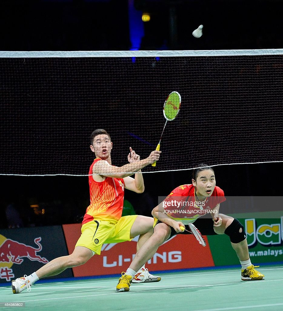 China s Liu Cheng L and Bao Yixin pete against China s Zhang