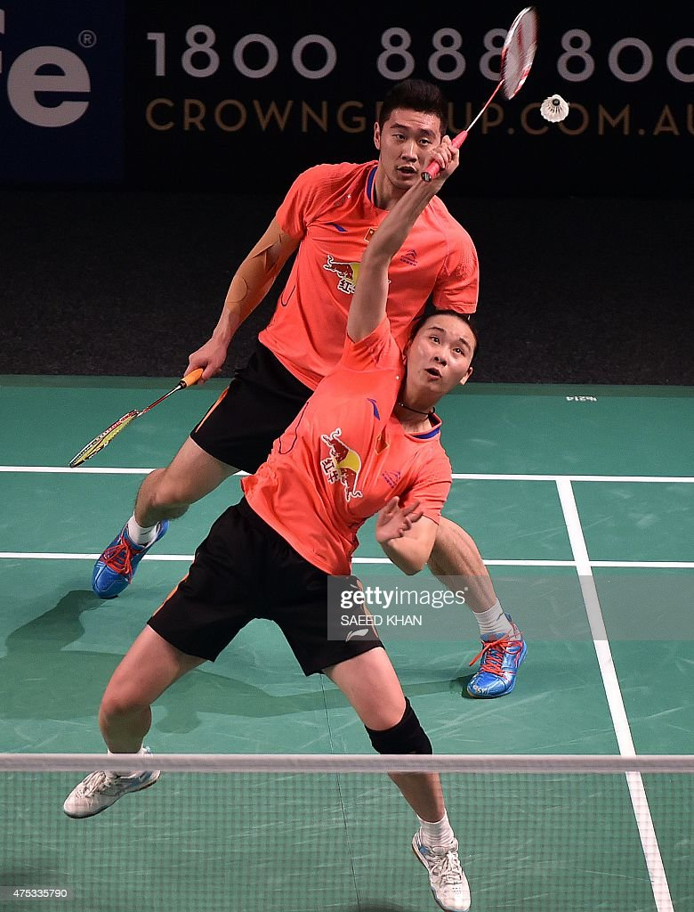 China s Liu Cheng and Bao Yixin R pete against Lee Chun Hei