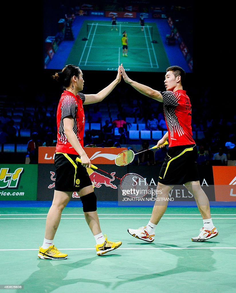China s Liu Cheng R and Bao Yixin react as they pete against
