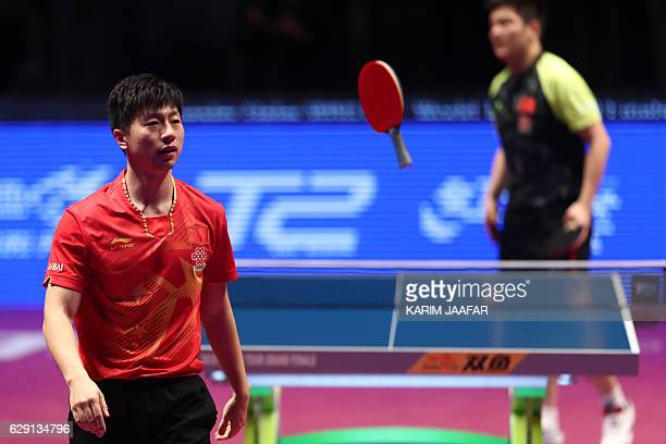 China's Ma Long celebrates after winning a point against China's Fan Zhendong during their men's singles final match as part of the Qatar 2016 ITTF...