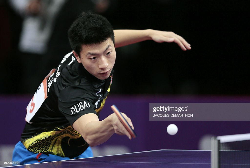 China's Ma Long returns a ball to China's Wang Hao on May 19, 2013 in Paris, during the semi-finals of the Men's Singles of the World Table Tennis Championships.