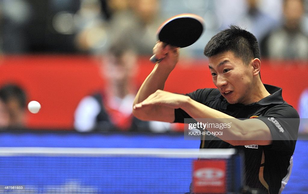 China's Ma Long returns a shot against Serbia's Marko Jevtovic during their match in the men's team championship division group A at the 2014 World Team Table Tennis Championships in Tokyo on May 1, 2014.