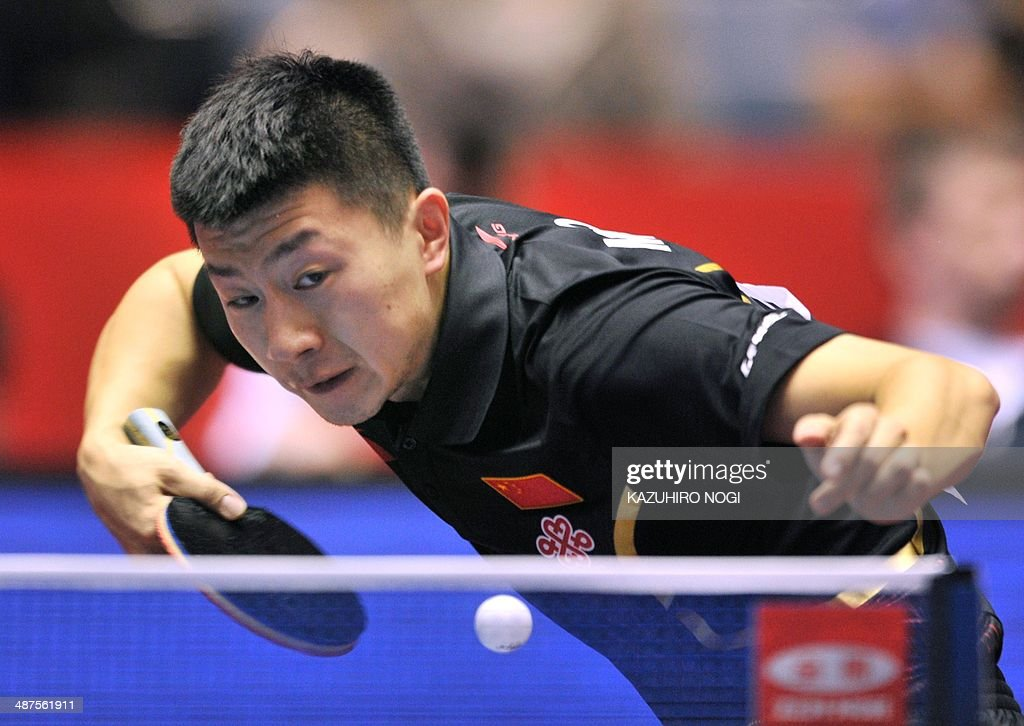 China's Ma Long serves against Serbia's Marko Jevtovic during their match in the men's team championship division group A at the 2014 World Team Table Tennis Championships in Tokyo on May 1, 2014. AFP PHOTO / KAZUHIRO NOGI