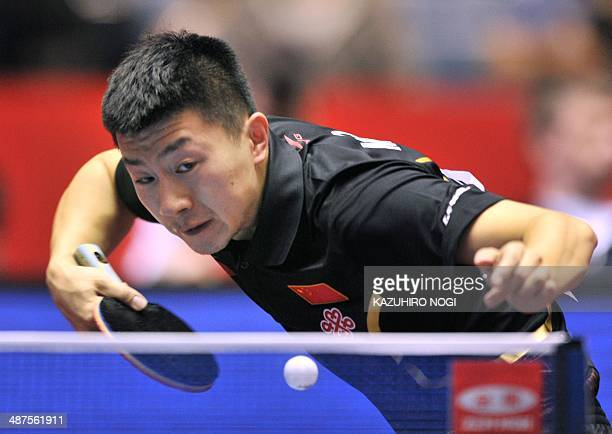 China's Ma Long serves against Serbia's Marko Jevtovic during their match in the men's team championship division group A at the 2014 World Team...