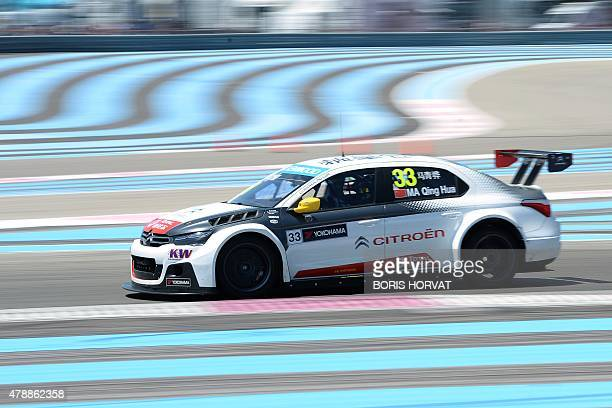 China's Ma Qing Hua competes in the FIA World Touring Car Championship in Le Castellet southern France on June 28 2015 AFP PHOTO / BORIS HORVAT