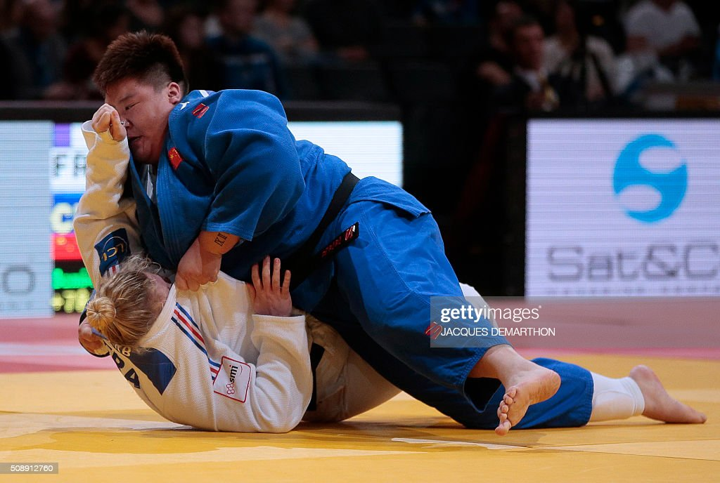 China's Ma Sisi (up) competes against France's Marine Erb during the women's over 78 kg semi-final at the Paris Grand Slam Judo tournament in Paris on February 7, 2016. Ma qualified for the final. / AFP / JACQUES DEMARTHON