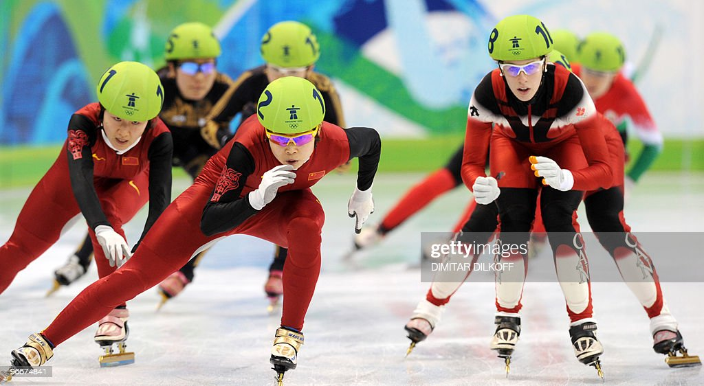 China's Meng Wang (C) and compatriot Linlin Sun compete with Canada's Marianne St-Gelais (R) in the Ladies' 3000 m Short Track relay semi-final race at Pacific Coliseum in Vancouver during the 2010 Winter Olympics on February 13, 2010.