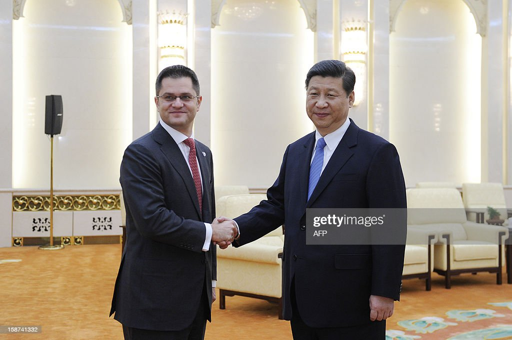 China's new Communist Party chief Xi Jinping (R) shakes hands with Vuk Jeremic (L), president of the 67th Session of the UN General Assembly, at the Great Hall of the People in Beijing on December 27, 2012. Jeremic is paying an official visit to China from December 26 to 28. AFP PHOTO / POOL /WANG ZHAO