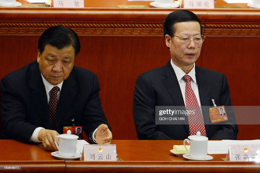 China's new NPC Chairman Liu Yunshan (L) and new Vice Premier Zhang Gaoli attend the closing session of the National People's Congress (NPC) at the Great Hall of the People in Beijing on March 17, 2013. President Xi Jinping said he would fight for a 'great renaissance of the Chinese nation', in his first speech as head of state of the world's most populous country. AFP PHOTO/GOH CHAI HIN