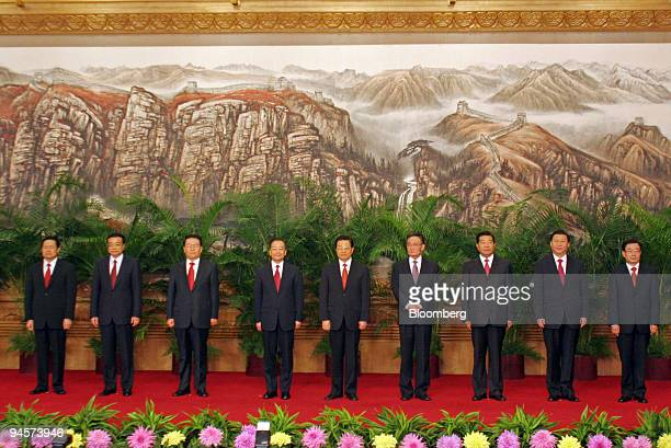 China's new Politburo Standing Committee members stand for a portrait in the Great Hall of the People in Beijing China on Monday Oct 22 2007 From...