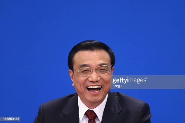 China's newly elected Premier Li Keqiang speaks during a news conference after the closing session of the National People's Congress at the Great...