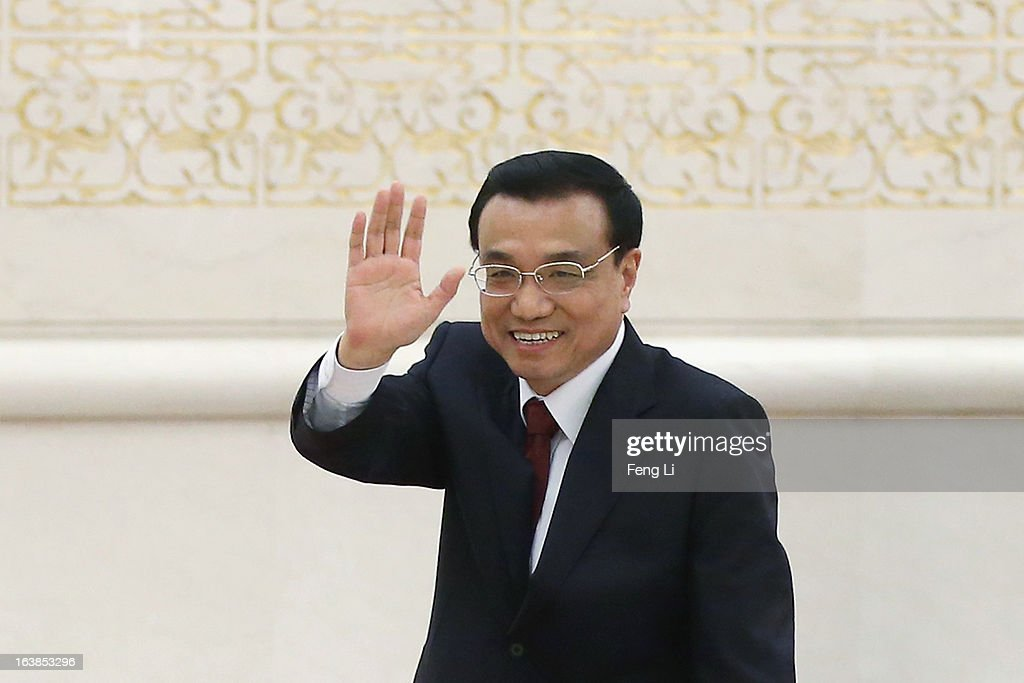China's newly elected Premier <a gi-track='captionPersonalityLinkClicked' href=/galleries/search?phrase=Li+Keqiang&family=editorial&specificpeople=2481781 ng-click='$event.stopPropagation()'>Li Keqiang</a> waves as he leaves a news conference after the closing session of the National People's Congress (NPC) at the Great Hall of the People on March 17, 2013 in Beijing, China. Chinese Premier <a gi-track='captionPersonalityLinkClicked' href=/galleries/search?phrase=Li+Keqiang&family=editorial&specificpeople=2481781 ng-click='$event.stopPropagation()'>Li Keqiang</a> has vowed to tackle with mounting problems of environment pollution and food safety on Sunday.