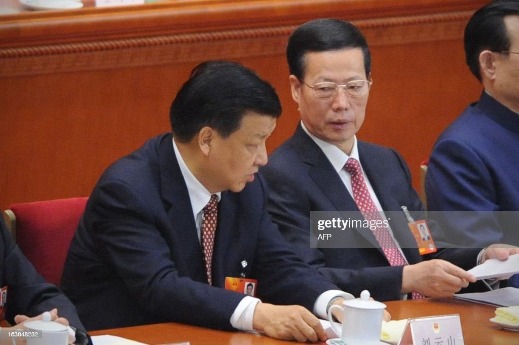 China's newly-elected NPC Chairman Liu Yunshan (L) talks with China's newly-elected Vice Premier Zhang Gaoli (R) at the closing session of the National People's Congress (NPC) at the Great Hall of the People in Beijing on March 17, 2013. President Xi Jinping said he would fight for a 'great renaissance of the Chinese nation', in his first speech as head of state of the world's most populous country. AFP PHOTO /WANG ZHAO