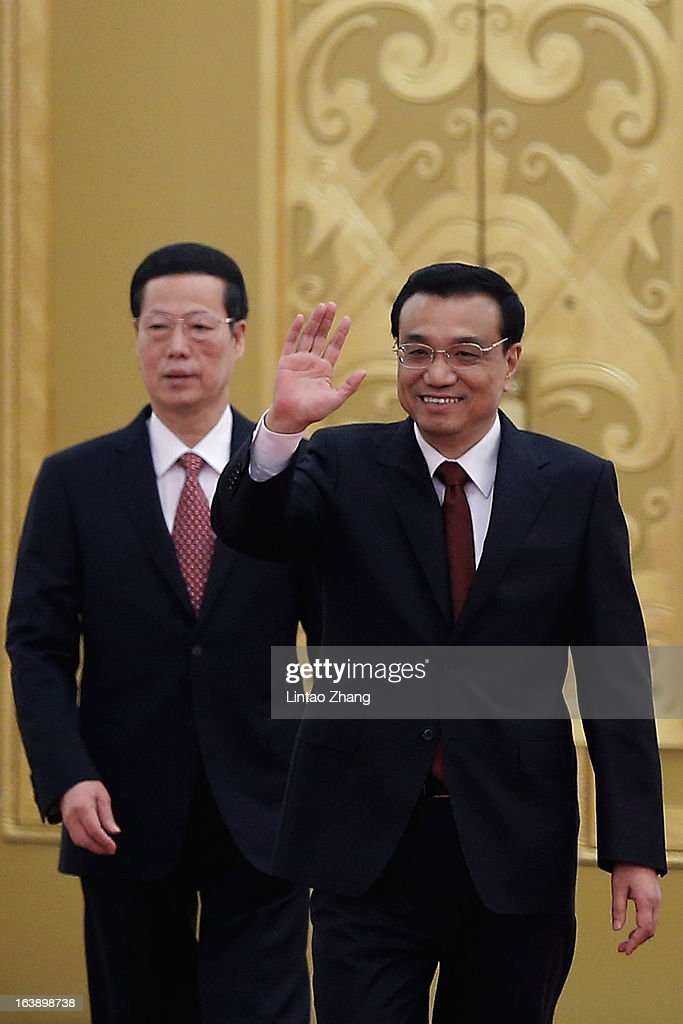 China's newly-elected Premier Li Keqiang (R) and newly-elected vice premiers Zhang Gaoli (L) attend a news conference after the closing session of the National People's Congress (NPC) at the Great Hall of the People on March 17, 2013 in Beijing, Li Keqiang was elected as China's Premier last Friday at the 12th National People's Congress, the country's top legislature.