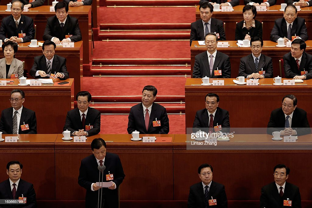 China's newly-elected President <a gi-track='captionPersonalityLinkClicked' href=/galleries/search?phrase=Xi+Jinping&family=editorial&specificpeople=2598986 ng-click='$event.stopPropagation()'>Xi Jinping</a> (Center) attend the fourth plenary meeting of the National People's Congress at the Great Hall of the People on March 14, 2013 in Beijing, China. <a gi-track='captionPersonalityLinkClicked' href=/galleries/search?phrase=Xi+Jinping&family=editorial&specificpeople=2598986 ng-click='$event.stopPropagation()'>Xi Jinping</a>, general secretary of the Communist Party of China Central Committee, was elected President of the People's Republic of China and Chairman of the Central Military Commission on Thursday.