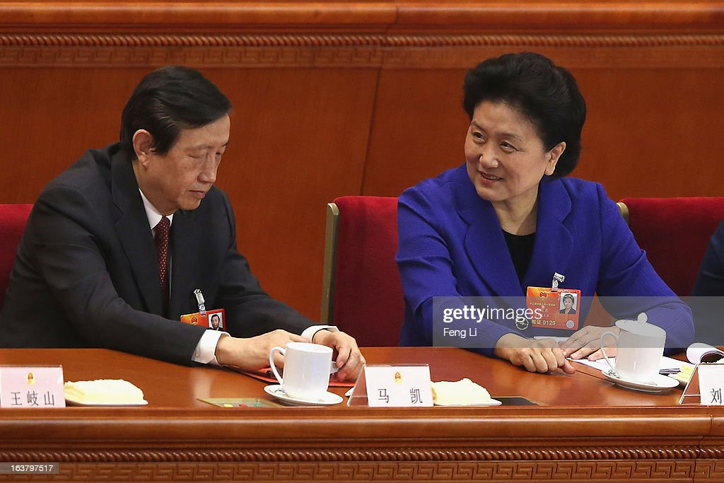 China's newly-elected Vice Premier Liu Yandong (R) and Ma Kai (L) attends the sixth plenary meeting of the National People's Congress at the Great Hall of the People on March 16, 2013 in Beijing, China. The new lineup of China's State Council, nominated by Premier Li Keqiang, was endorsed by lawmakers at the ongoing national legislative session Saturday afternoon.