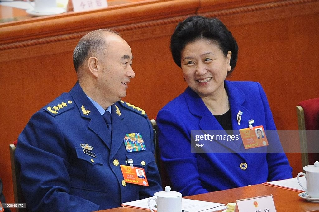 China's newly-elected Vice Premier Liu Yandong chats with China's newly-elected Vice Chairman of the Central Military Commission (CMC) of the People's Republic of China at the closing session of the National People's Congress (NPC) at the Great Hall of the People in Beijing on March 17, 2013. President Xi Jinping told the country's military to improve its ability to 'win battles' in his first speech as head of state, as Beijing is embroiled in a bitter territorial row with Japan.