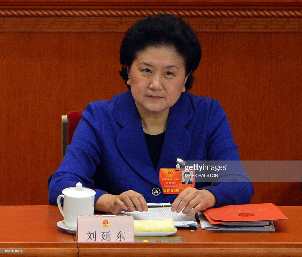 China's newly-elected Vice Premier Liu Yandong looks on during the election of the new vice premiers, foreign and defence ministers of China during the 12th National People's Congress (NPC) in the Great Hall of the People in Beijing on March 16, 2013. China's parliament named Xi Jinping as president on March 15 four months after he took charge of the Communist Party with pledges of reform that have raised hopes but so far yielded little change. AFP PHOTO / Mark RALSTON