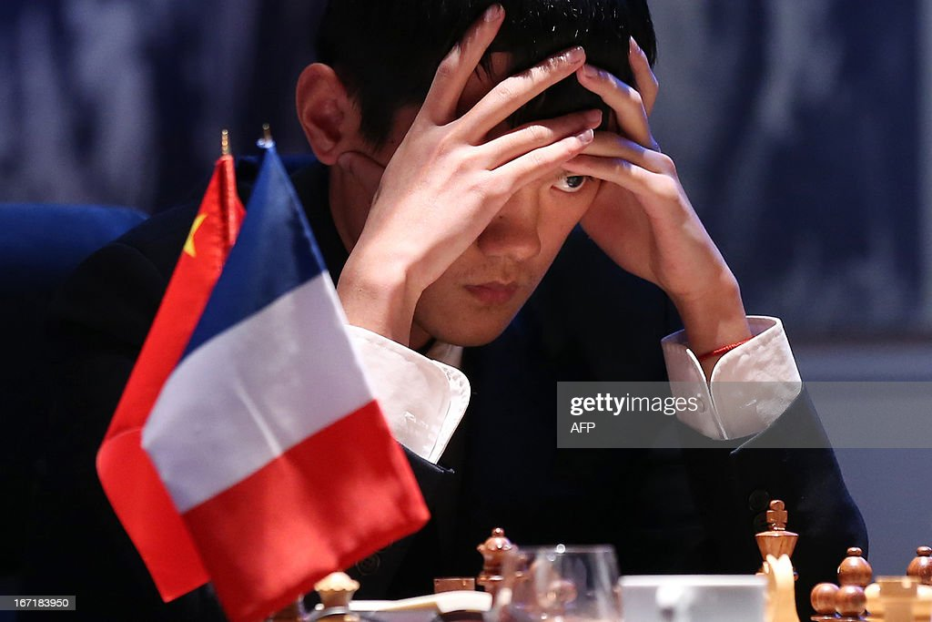 China's number one Ding Liren plays during a round 2 game of the Alekhine Memorial chess tournament on April 22, 2013 in Paris. The tournament is a 10-player single round competition, with the first half held in Paris from April 20 to 25, and the second half in the Russian State Museum in St. Petersburg from APril 26 to May 1st.
