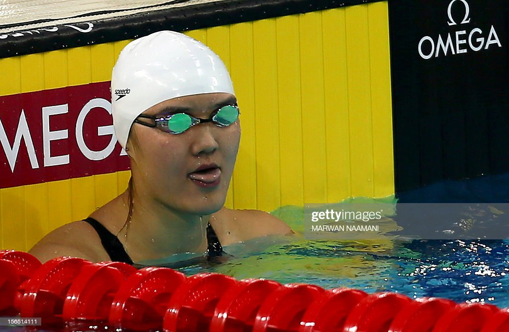 China's Pang Jiaying reacts after winning the women's 200m freestyle final during the 9th Asian Swimming Championships in Dubai on November 16, 2012.