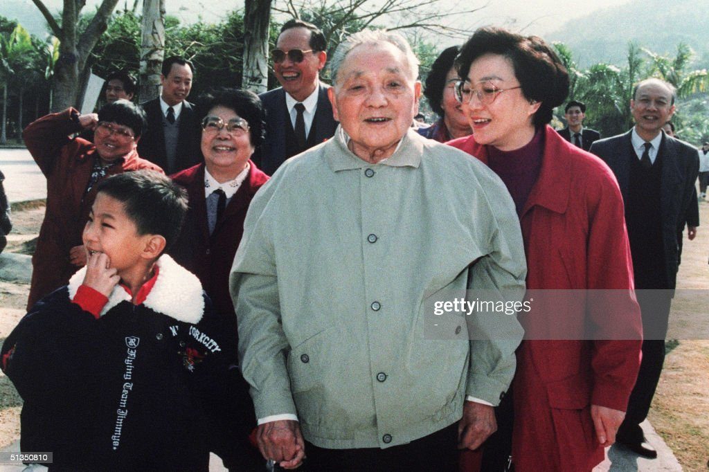 China's paramount leader Deng Xiaoping surrounded by his daughters Deng Lin Chiah Lin Deng Rong and grandson takes a walk in January 1992 during his...