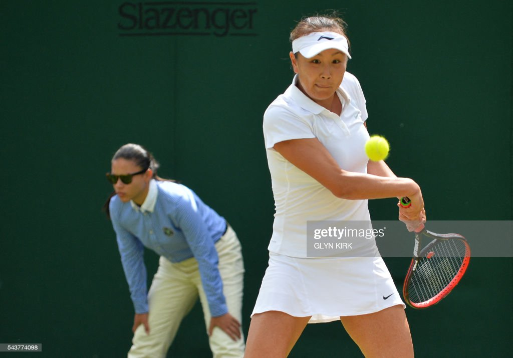 China's Peng Shuai returns to US player Sloane Stephens during their women's singles second round match on the fourth day of the 2016 Wimbledon Championships at The All England Lawn Tennis Club in Wimbledon, southwest London, on June 30, 2016. / AFP / GLYN