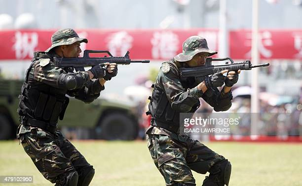 China's Peoples' Liberation Army soldiers perform a drill at the Ngong Shuen Chau Barracks in Hong Kong on July 1 to mark the 18th anniversary of...
