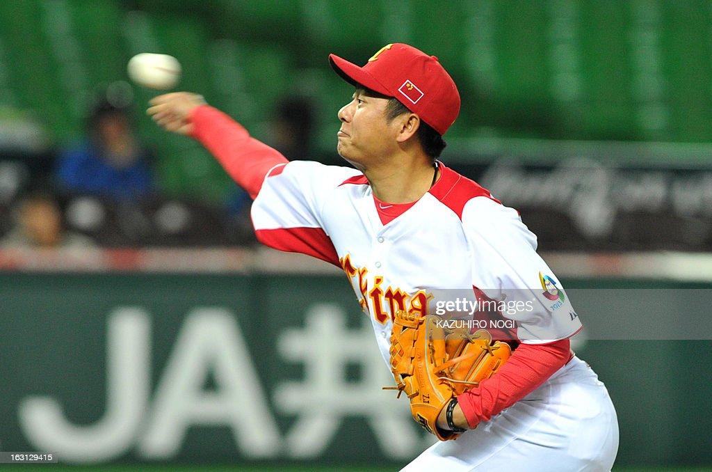 China's pitcher Lu Jiangang throws the ball against Brazil during the eighth inning of their first-round Pool A game in the World Baseball Classic tournament in Fukuoka on March 5, 2013. China beat Brazil 5-2. AFP PHOTO / KAZUHIRO NOGI