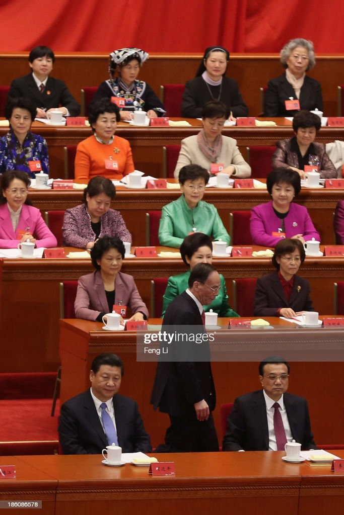 China's Politburo Standing Committee member <a gi-track='captionPersonalityLinkClicked' href=/galleries/search?phrase=Wang+Qishan&family=editorial&specificpeople=692964 ng-click='$event.stopPropagation()'>Wang Qishan</a> (Bellow Center) walks past President <a gi-track='captionPersonalityLinkClicked' href=/galleries/search?phrase=Xi+Jinping&family=editorial&specificpeople=2598986 ng-click='$event.stopPropagation()'>Xi Jinping</a> (Bellow Left) and Premier <a gi-track='captionPersonalityLinkClicked' href=/galleries/search?phrase=Li+Keqiang&family=editorial&specificpeople=2481781 ng-click='$event.stopPropagation()'>Li Keqiang</a> (Bellow Right) after speaking during the opening ceremony of the 11th National Women's Congress at the Great Hall of the People near Tiananmen Square on October 28, 2013 in Beijing, China. All 1,510 formal delegates and 156 specially invited delegates attend opening ceremony of the 11th National Women's Congress at the Great Hall of the People near the Tiananmen Square on Monday.
