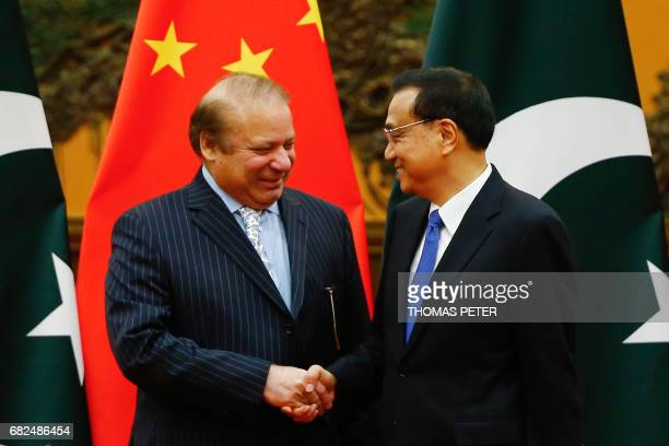 China's Premier Li Keqiang and Pakistan's Prime Minister Nawaz Sharif shak hands during a signing ceremony at the Great Hall of the People in Beijing...