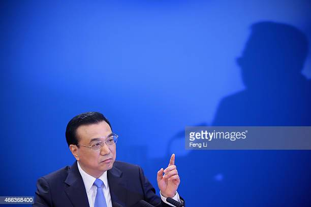 China's Premier Li Keqiang answers question during the annual news conference following the closing session of the National People's Congress at the...